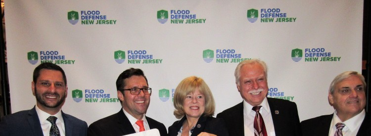 Assemblywoman Nancy Pinkin (D-18), Chair of Assembly Environment Committee and prime sponsor of the Assembly Flood Defense Act (A2694/S1073), poses with districtmate Assemblyman Robert Karabinchak (D-18), Ed Potosnak, and friends at Flood Defense NJ's League of Municipalities reception.